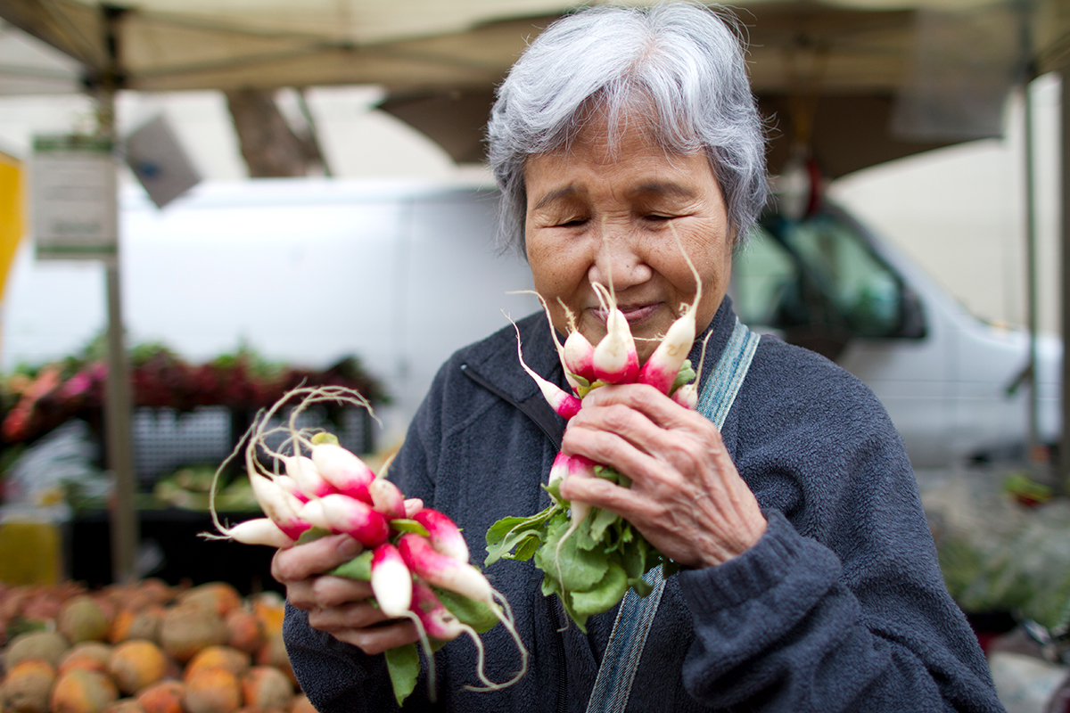 Woman Smelling Radishes