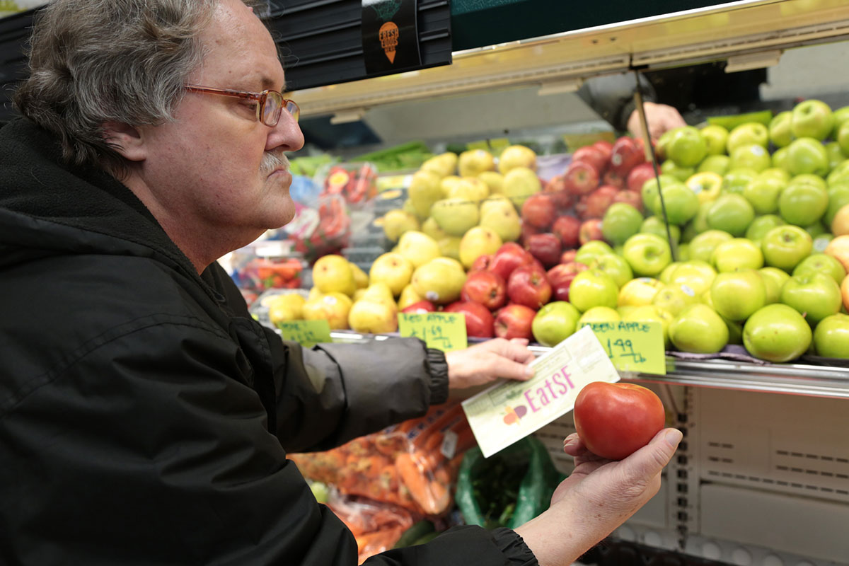 Man Holding Tomato and EatSF Voucher