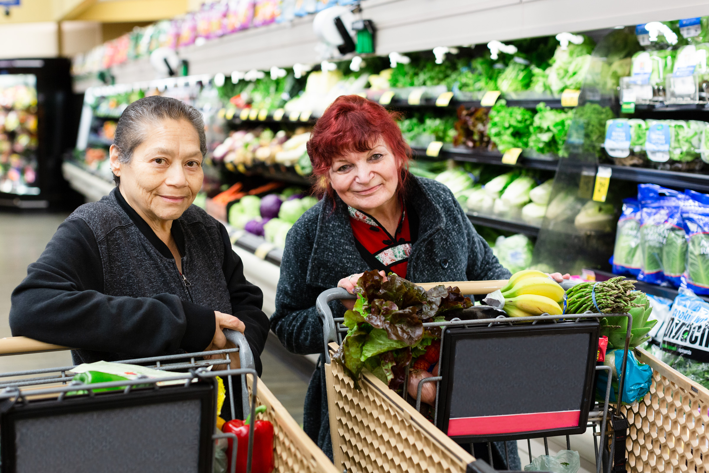 Seniors shopping for produce together
