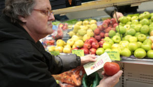 Man Buying Apples with EatSF Voucher