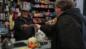 Man Handing Food Voucher to Cashier