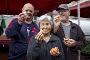 People holding oranges