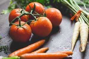 Fresh vegetables: tomatoes and carrots
